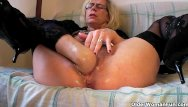 Mature woman in heels - Perverted granny fists her hairy pussy
