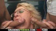 Granny slut Old granny slut takes two cocks in the fields