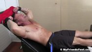 Gay fetish on the - Muscular gay strapped in to have his feet and body tickled
