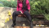 Gothis porn Brunette hottie takes huge long piss on bench in public