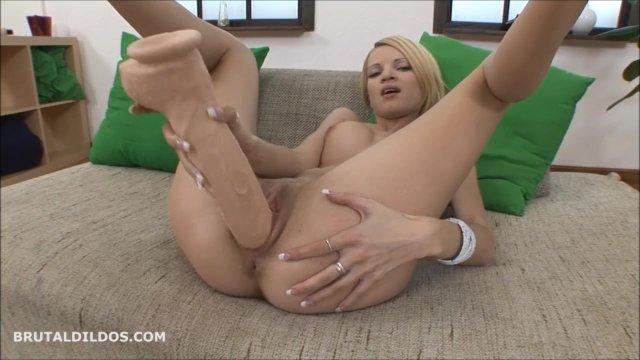 Tight blonde fucks a big brutal dildo