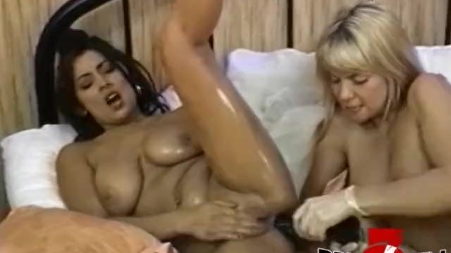 Lesbian anal play going wild with two busty vixens