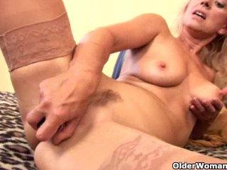 Senior blonde in stockings fucks a dildo
