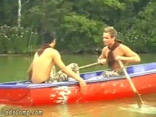 Steamy gay fucking in a little boat