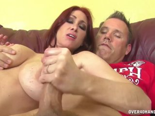 Busty redhead milf jerks off a boner