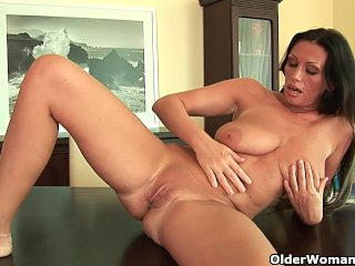 Soccer mom with heavy boobs is dildoing