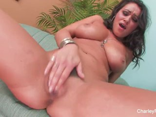 Sexy Charley rubs & fingers her wet pussy