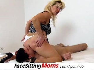 Busty granny Hana uses a boy for cunt licking