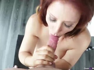 Redhead milf jerking a young guy's cock