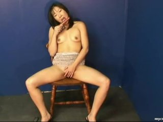 Fantastic Asian babe rubbing on her wet pussy
