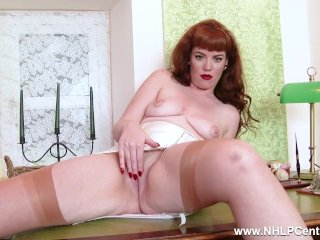 Redhead babe Zoe Page strip teases showing off nyloned legs bare trim pussy