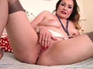Busty Sophia Delane wanks in tan nylons after stripping off retro lingerie