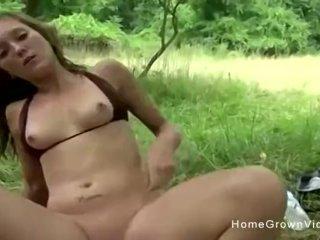 Petite brunette cutie masturbates then fucks outdoors