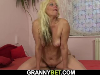 Old blonde woman enjoys riding his horny cock