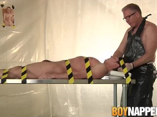 Dominant Sebastian Kane restrains submissive gay for torture