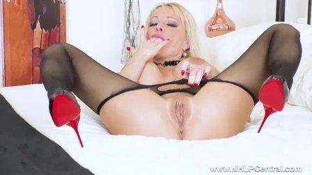 Busty blonde Milf Tara Spades wanks off in sheer black pantyhose stilettos