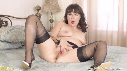 Horny brunette Cherri masturbates for you in sheer black nylons and heels
